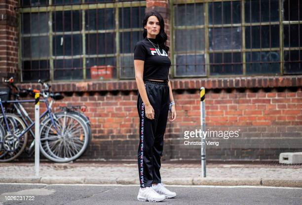 Catherine Poulain wearing Fila track suit pants and tshirt with name print white sneakers seen during the BreadButter by Zalando at Arena Berlin on...