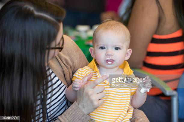 Catherine right and mom enjoying cupcakes at a party in honor of Eversource's longstanding commitment of Boston Children's Hospital on June 7 2017 in...