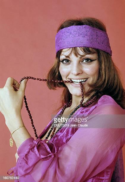 Catherine Rouvel Poses In Studio France 1969 Portrait studio de Catherine ROUVEL actrice française bandeau de tissu violet ceignat son front vêtue...