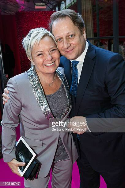 Catherine Salvador and Olivier Perruchot attend the Piaget Rose Day Private Event in Orangerie Ephemere at Jardin des Tuileries on June 13 2013 in...