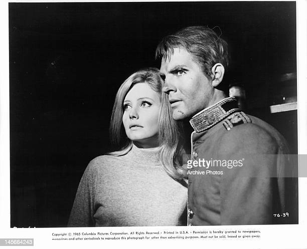 Catherine Schell and Eddi Arent standing together in concern in a scene from the film 'Das Verrätertor' 1965