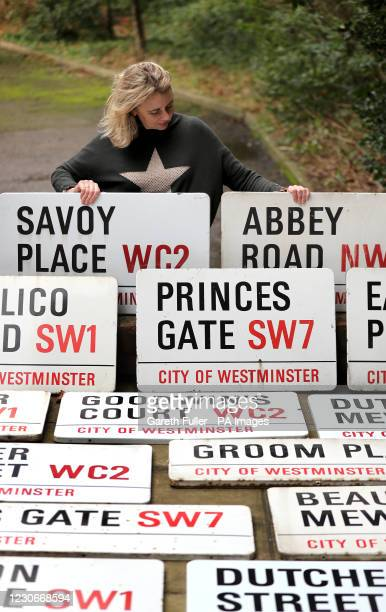 Catherine Southon amongst some of 260 London street signs before before they go up for an online auction next month at Catherine Southon Auctioneers...