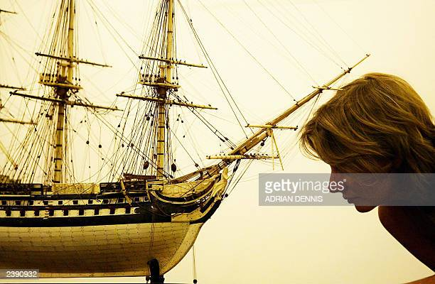Catherine Southon, an auction marine specialist, examines a large fine-bone prisoner of war model ship at Sotheby's auction house at Olympia in...
