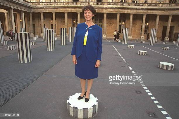 Catherine Tasca French Cultural Affairs Minister on a Buren column in front of her Ministry at the Palais Royal
