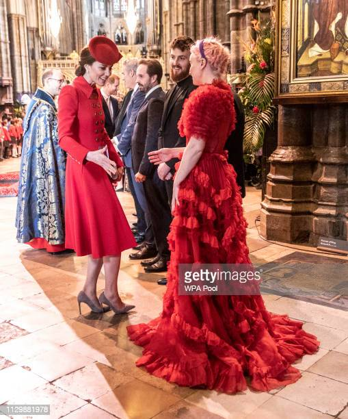 Catherine The Duchess of Cambridge admires the dress worn by Grace Chatto of the group Clean Bandit who performed at Westminster Abbey Commonwealth...