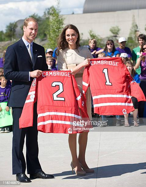 Catherine the Duchess of Cambridge and Prince William Duke of Cambridge are presented with hockey shirts as they visit the Somba K'e Civic Plaza on...