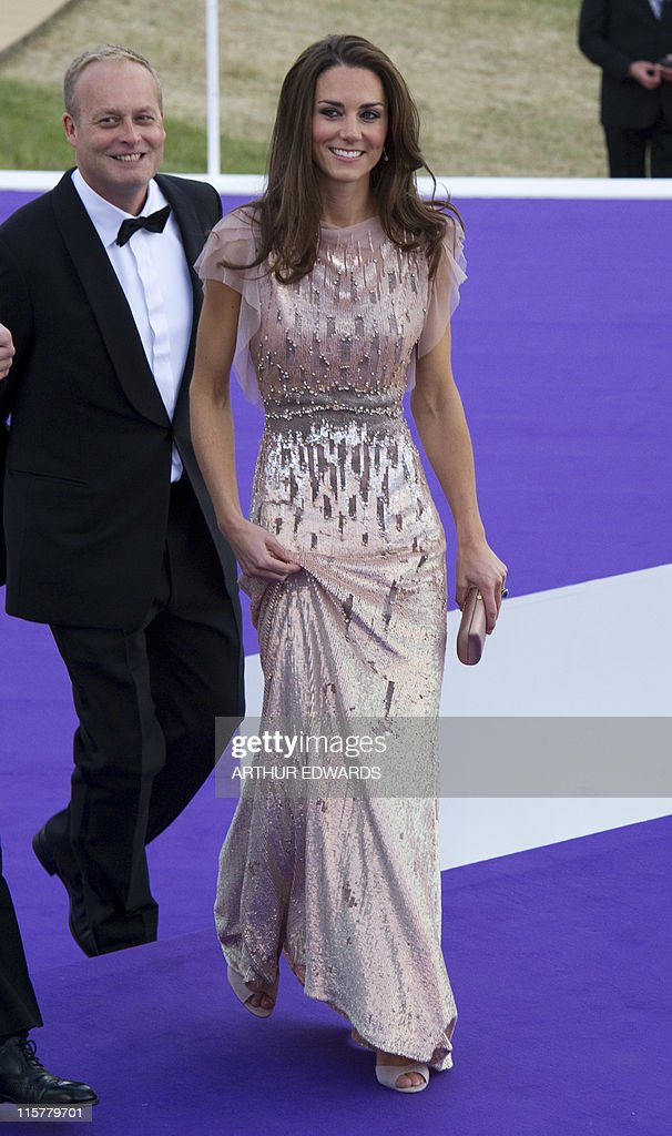 Catherine, the Duchess of Cambridge, attends the 10th Annual Absolute Return for Kids (ARK) Gala Dinner on behalf of the Foundation of Prince William and Prince Harry, at Perks Field, Kensington Palace, in London, on June 9, 2011. AFP PHOTO / POOL / Arthur Edwards