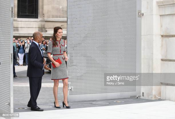 Catherine the Duchess of Cambridge is escorted to a tour during an official visit to the new VA exhibition road quarter at Victoria Albert Museum on...