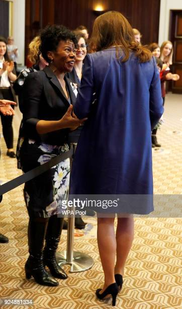 Catherine the Duchess of Cambridge is greeted by Professor Jacqueline DunkleyBent during a visit to Royal College of Obstetricians and Gynaecologists...