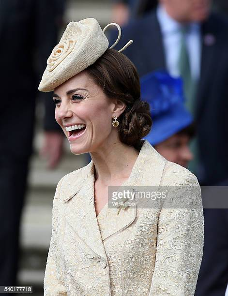 Catherine the Duchess of Cambridge laughs as she attends the Secretary of State for Northern Ireland Theresa Villiers' Garden Party at the royal...