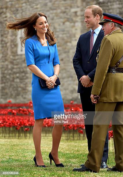 Catherine, The Duchess of Cambridge, Prince William, Duke of Cambridge stand with Lord Dannatt as they visit The Tower of London's 'Blood Swept Lands...