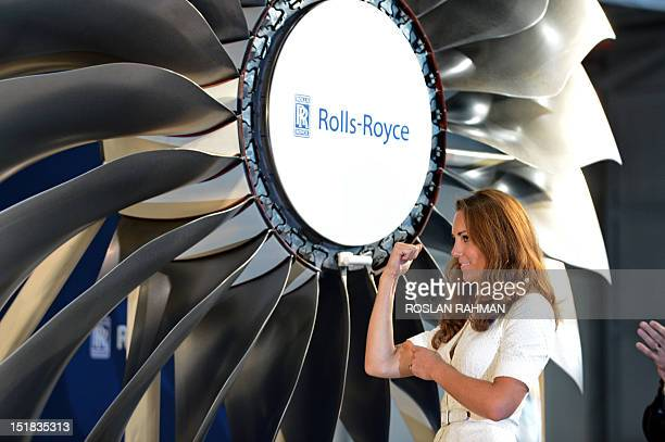 Catherine the Duchess of Cambridge reacts after officiating a launch event at the Rolls Royce plant in Singapore on September 12 2012 Britain's...
