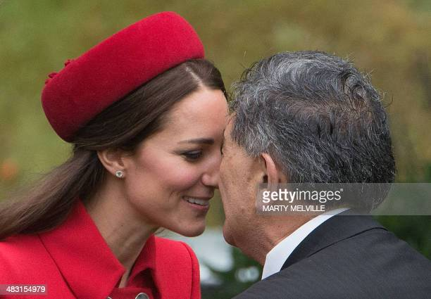 """Catherine , the Duchess of Cambridge, receives a """"hongi"""", a traditional Maori greeting, by a Maori elder during a welcoming at Government House in..."""