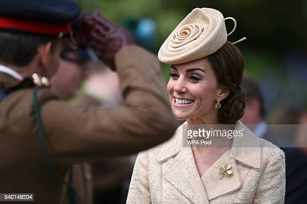 Catherine the Duchess of Cambridge receives a salute from a soldier during a garden party at Hillsborough Castle Northern Ireland June 14 2016