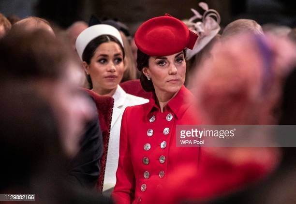 Catherine The Duchess of Cambridge sits near Meghan Duchess of Sussex as they attend the Westminster Abbey Commonwealth day service on March 11 2019...