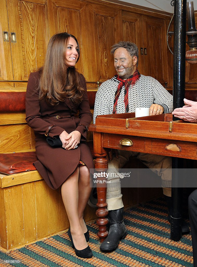 Catherine, The Duchess of Cambridge sits next to a dummy of the Ship's Mate at the Skipper's Table during her tour of the National Fishing Heritage Centre, Grimsby.