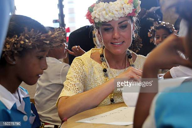 Catherine , the Duchess of Cambridge, speaks to a student as she visits the Nauti Primary School, the main government primary school in Tuvalu in...