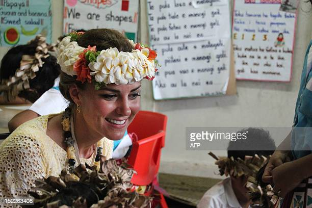 Catherine , the Duchess of Cambridge, speaks to students as she visits the Nauti Primary School, the main government primary school in Tuvalu during...