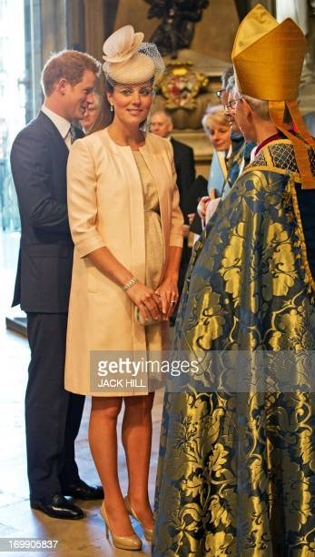 Catherine The Duchess of Cambridge speaks with The Archbishop if Canterbury Justin Welby as Prince Harry looks on during a service to Celebrate the...