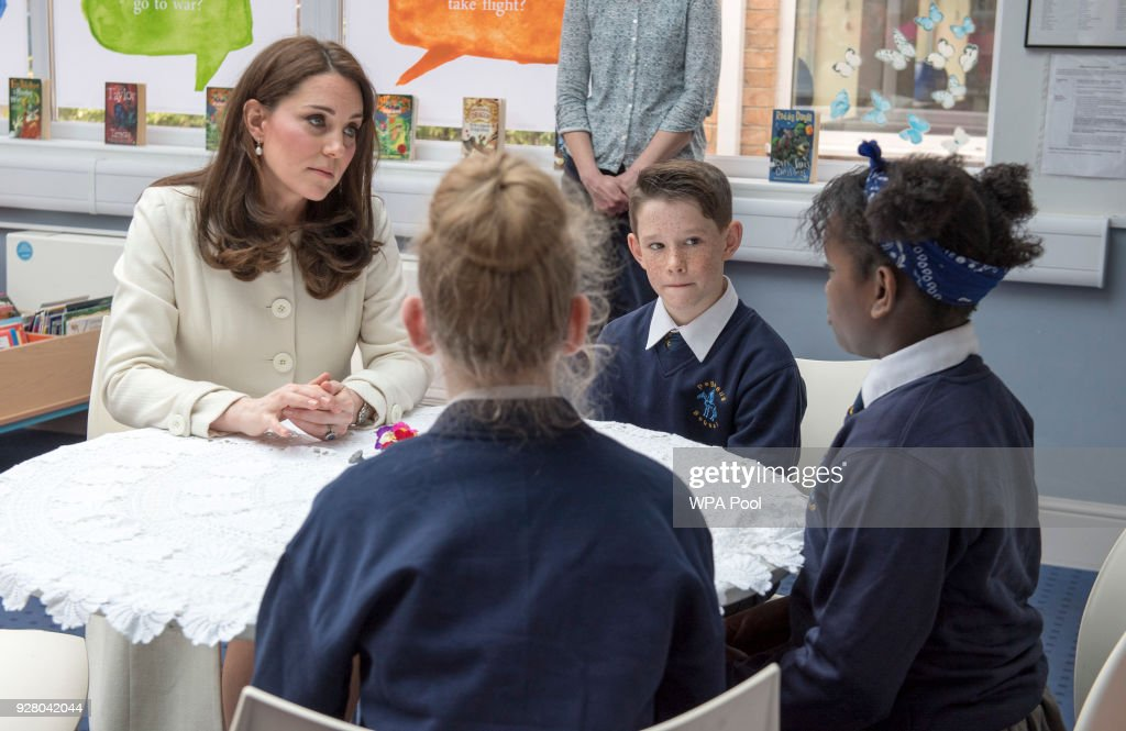 Catherine, The Duchess of Cambridge speaks with with pupils Jodie, Zhara and Emilia during a visit to to learn about the work of the charity Family Links which works closely with schools nationwide to support both children and parents with their emotional health and wellbeing, with an emphasis on early intervention during a visit to Pegasus Primary School in Oxford on March 6, 2018 in Oxford, England.