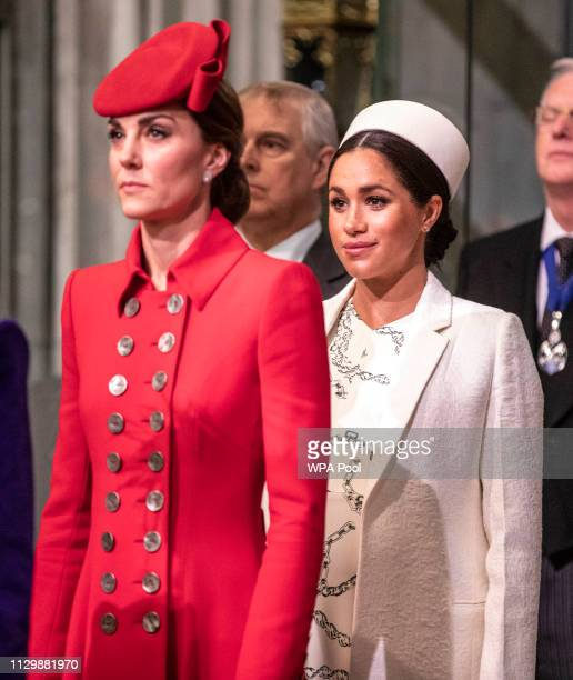 Catherine, The Duchess of Cambridge stands with Meghan, Duchess of Sussex at Westminster Abbey for a Commonwealth day service on March 11, 2019 in...