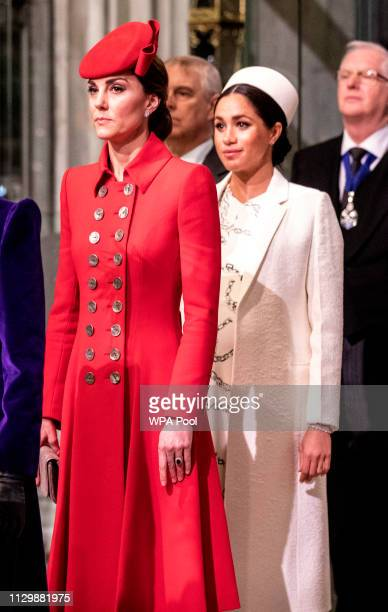 Catherine The Duchess of Cambridge stands with the Meghan Duchess of Sussex at Westminster Abbey for a Commonwealth day service on March 11 2019 in...