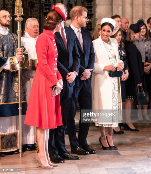 Catherine The Duchess of Cambridge talks with Meghan Duchess of Sussex at Westminster Abbey Commonwealth day service on March 11 2019 in London...