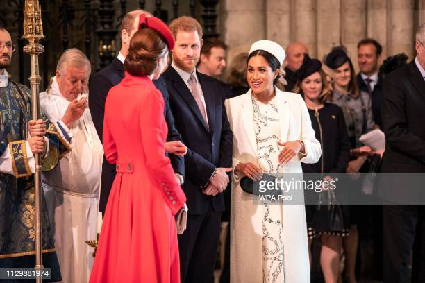 Catherine The Duchess of Cambridge talks with the Meghan Duchess of Sussex at Westminster Abbey Commonwealth day service on March 11 2019 in London...