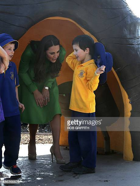 Catherine, the Duchess of Cambridge , walks out of a pod as she walks through the Pod Playground during a visit to the National Arboretum in Canberra...