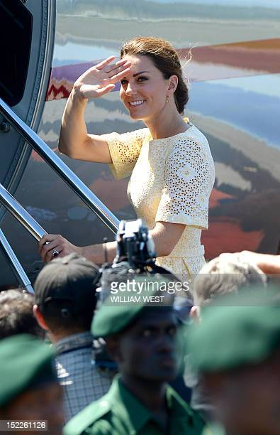 Catherine the Duchess of Cambridge waves farewell as she and her husband Prince William leave the Solomon Islands from Honiara on September 18 2012...