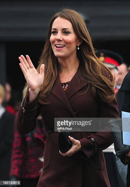 Catherine The Duchess of Cambridge waves to the crowds during her visit outside the National Fishing Heritage Centre on March 5 2013 in Grimsby...