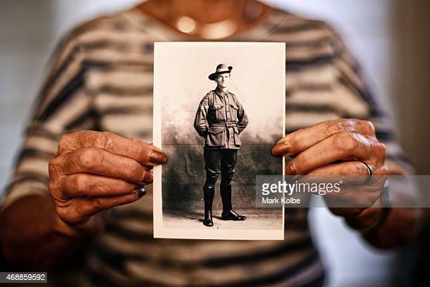 Catherine Thredgold the daughter of Corporal Bryan M Francis an ANZAC veteran of the 10th Battalion at Gallipoli holds a wartime photograph of her...