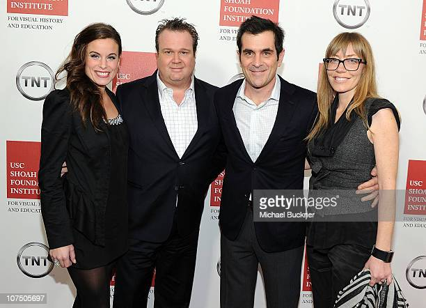 Catherine Tokarz actor Eric Stonestreet actor Ty Burrell and wife Holly Burrell attend the Ambassadors for Humanity Gala to benefit the USC Shoah...