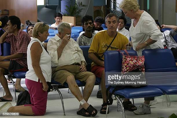 Catherine van Duren's partner Jan is comforted by Margaret Spratt and Mrs Spratt's husband Michael and Mrs Van Duren's daughter Ingrid Hastie 29...