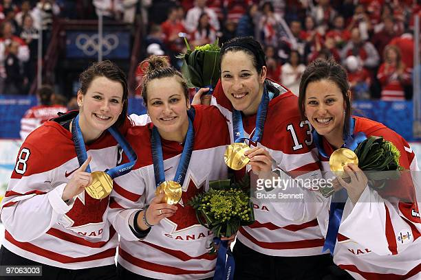Catherine Ward, Marie-Philip Poulin, Caroline Ouellette and Charline Labonte of Canada celebrate with the gold medals following their team's 2-0...