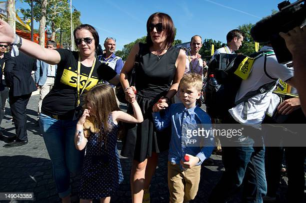 Catherine Wiggins the wife of Tour de France 2012 winner Yellow jersey British Bradley Wiggins arrives with their children on the ChampsElysees...