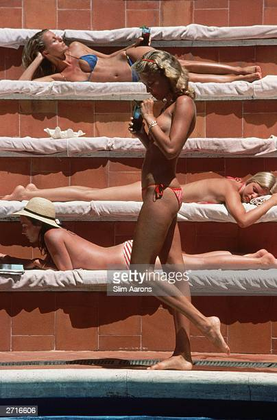 Catherine Wilke joins the topless sunbathers at the Hotel Punta Tragara on the island of Capri Italy 1980