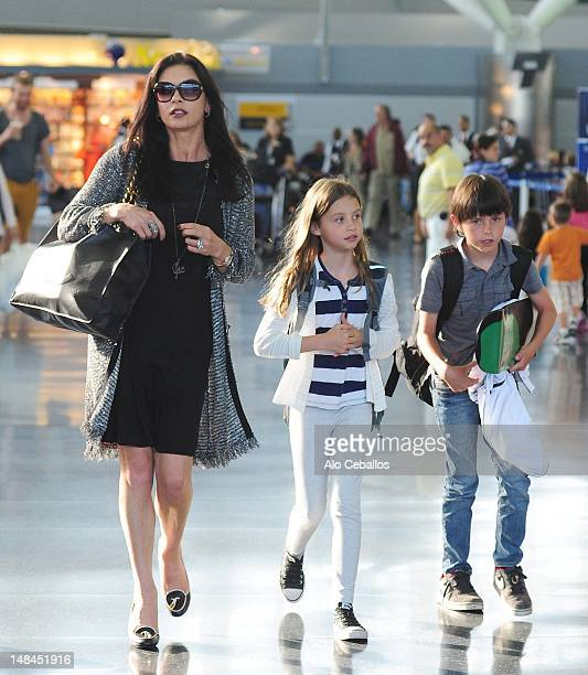 Catherine Zeta Jones and Carys Zeta Douglas and Dylan Michael Douglas are seen at JFK airport at Streets of Manhattan on July 16 2012 in New York City