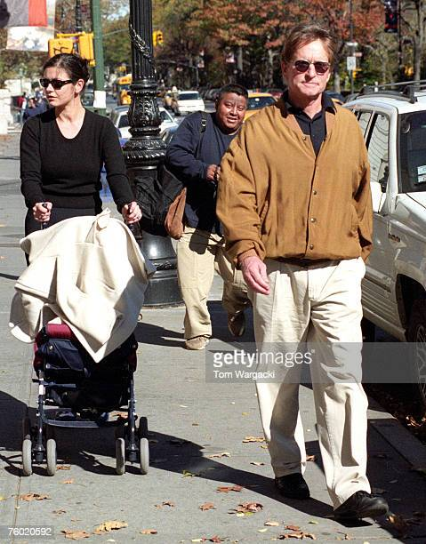 Catherine Zeta Jones and Michael Douglas with their son Dylan walking on Central Park West and 76th Street on October 28 2000 in New York City