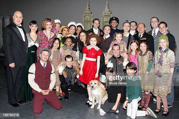 Catherine Zeta Jones Carys Douglas and Dylan Douglas pose with the cast backstage at the hit musical Annie on Broadway at The Palace Theater on...