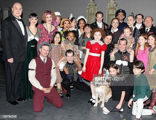 Catherine Zeta Jones Carys Douglas and Dylan Douglas pose with the cast backstage at the hit musical 'Annie' on Broadway at The Palace Theater on...