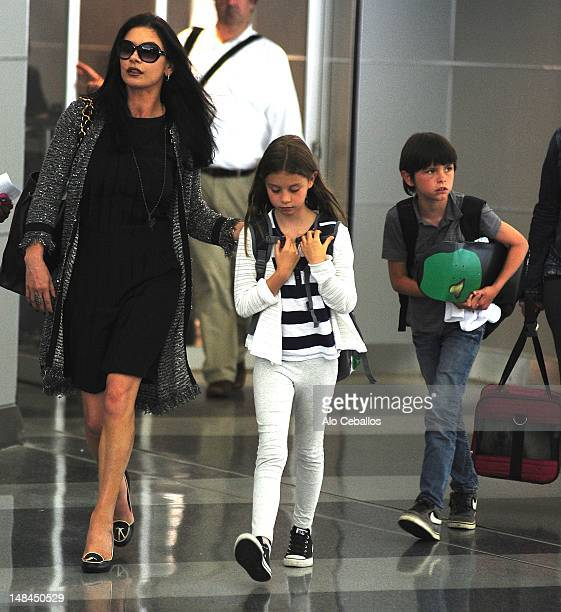 Catherine Zeta Jones Carys Zeta Douglas and Dylan Michael Douglas are seen at JFK airport on July 16 2012 in New York City