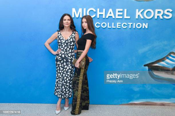 Catherine ZetaJones and Carys Zeta Douglas attend Michael Kors Collection Spring 2019 Runway Show at Pier 17 on September 12 2018 in New York City