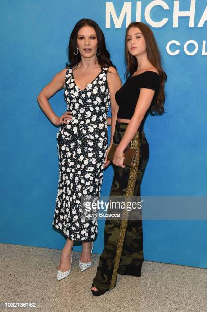 Catherine ZetaJones and Carys Zeta Douglas attend the Michael Kors Collection Spring 2019 Runway Show at Pier 17 on September 12 2018 in New York City