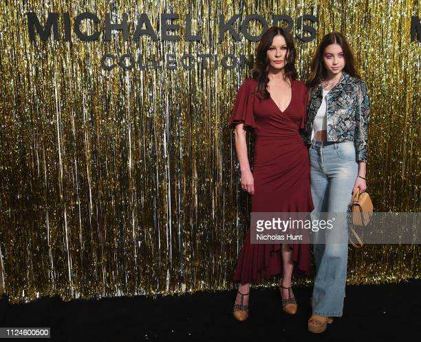 Catherine ZetaJones and Carys Zeta Douglas attend the Michael Kors Collection Fall 2019 Runway Show at Cipriani Wall Street on February 13 2019 in...