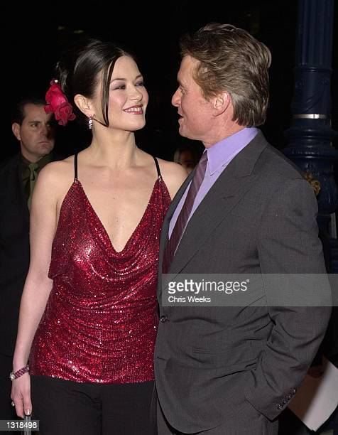 Catherine ZetaJones and her husband Michael Douglas arrive at the premiere of USA Films'' 'Traffic' December 14 2000 at the Academy of Motion...