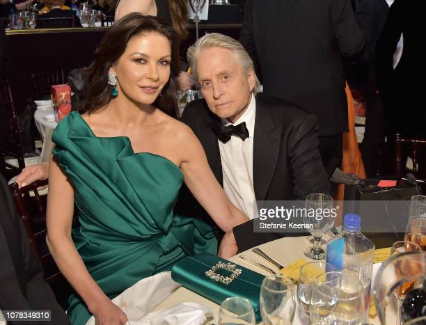 Catherine ZetaJones and Michael Douglas attend FIJI Water at the 76th Annual Golden Globe Awards on January 6 2019 at the Beverly Hilton in Los...