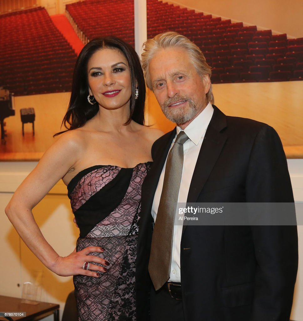 Catherine Zeta-Jones and Michael Douglas pose backstage during 'City Winery Presents A Celebration of the Music of Jimmy Webb' at Carnegie Hall on May 3, 2017 in New York City.