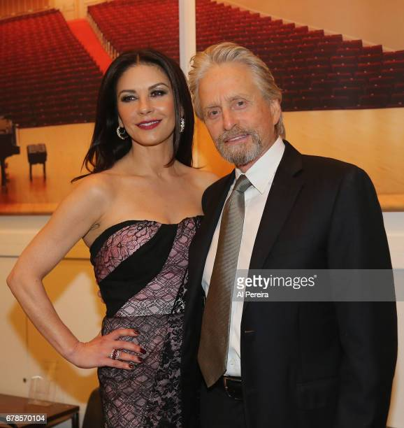 Catherine ZetaJones and Michael Douglas pose backstage during 'City Winery Presents A Celebration of the Music of Jimmy Webb' at Carnegie Hall on May...