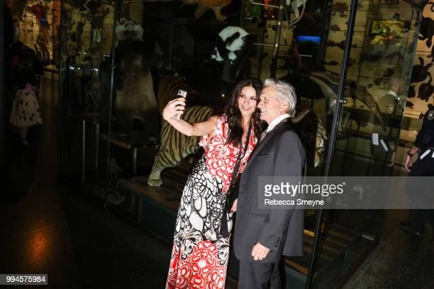 Catherine ZetaJones and Michael Douglas take a selfie the PEN Literary Gala at the American Museum of Natural History on May 22 2018 in New York New...